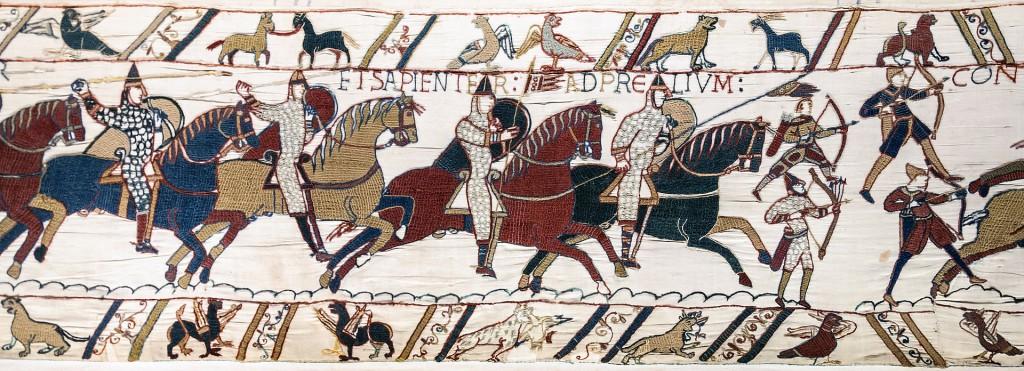 Normanští rytíři a lučištníci v bitvě u Hastings (zobrazení na tapistérii z Bayeux)